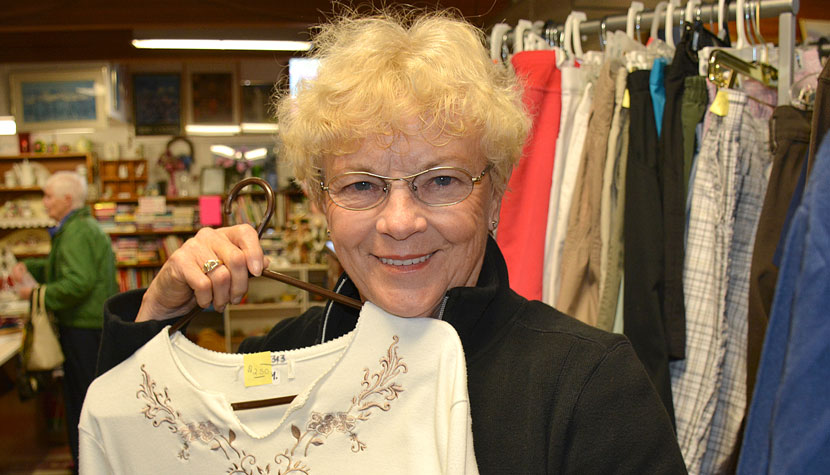 Anne Polischuk, manager of the Osoyoos United Church Thrift Shop, displays some of the clothing in stock. The Dorcas Ladies Group, which runs the shop, has donated $30,000 to the SOS  Medical Foundation to help equip the new Patient Care Tower at PRH.