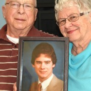 Penticton residents Harold and Donna Schellenberg hold a photo of their late son Vance, who was killed in a helicopter crash in 1990.  The Schellenbergs are donating $30,000 to the SOS Medical Foundation to help provide medical equipment for the Penticton Regional Hospital expansion.