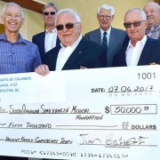 Christopher Society of Penticton trustees present $50,000 for Penticton Regional Hospital to Carey Bornn of the South Okanagan Similkameen Medical Foundation.  The trustees, all Knights of Columbus Council 3127 members, include president Jim Calvert (front centre), Dennis Ebner, and (back row from left) Len Breault, Rene Barone, Rick Wheeler and Woody Aschenbrenner. Missing from photo is Gene Lukey.